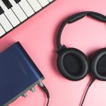 Canva Computer Home Music studio set up on pink scaled e1579035003673