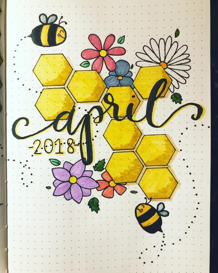 april bullet journal spread with bees