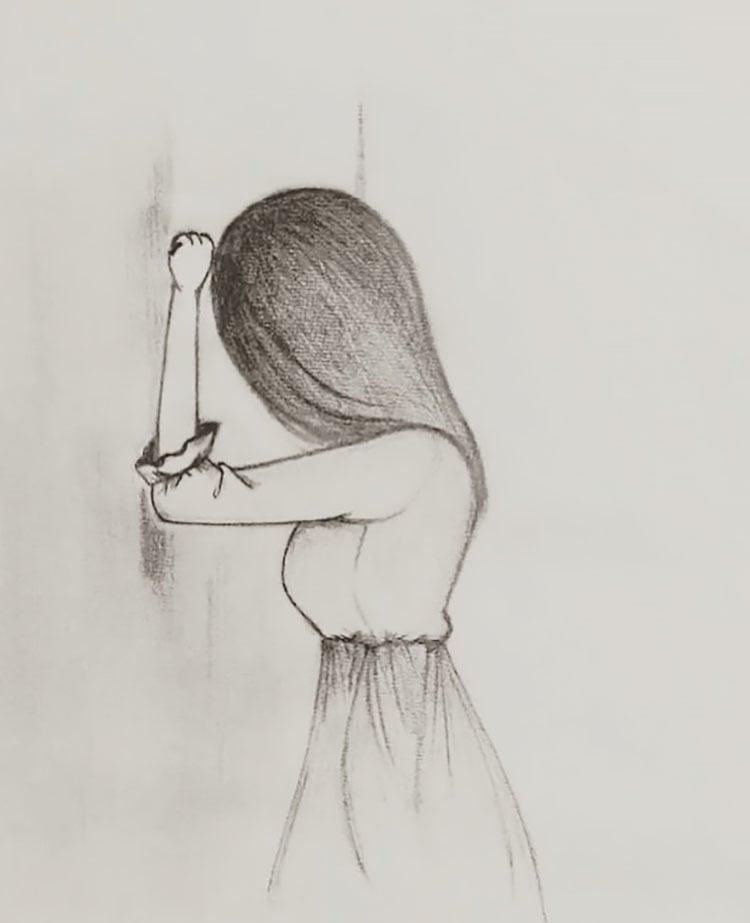 GIRL TOUCHING WALL