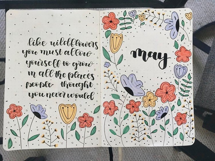 may bullet journal cover page with quotes and wildflowers