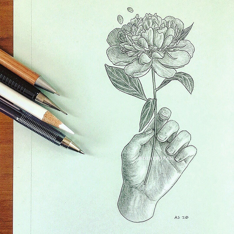 HAND HOLDING FLOWER DRAWING