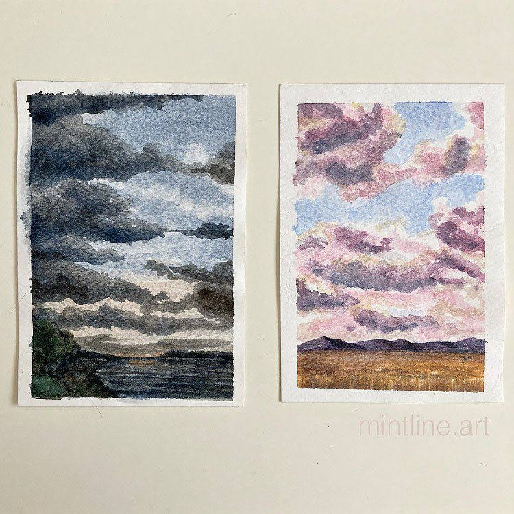 TWO WATERCOLOR SKY PAINTINGS ONE WITH DARK SKY ONE WITH LIGHT SKY