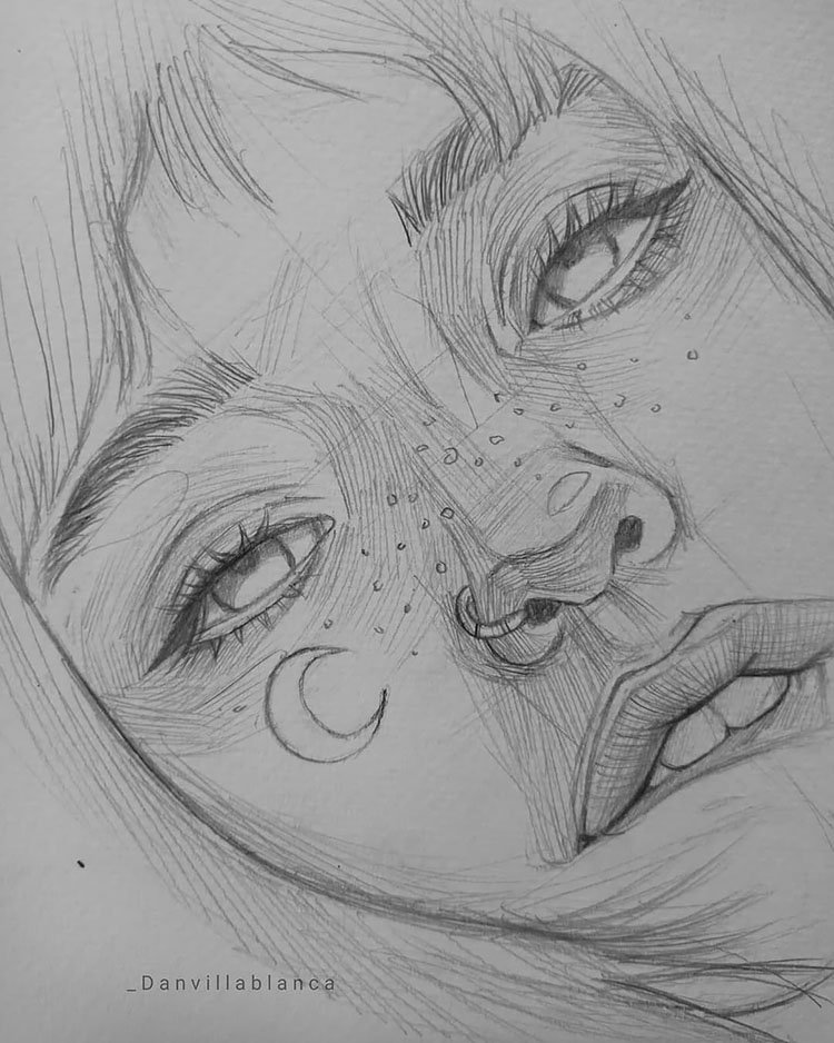 girl with freckles drawing