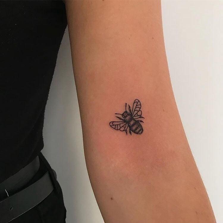 simple black bee tattoo