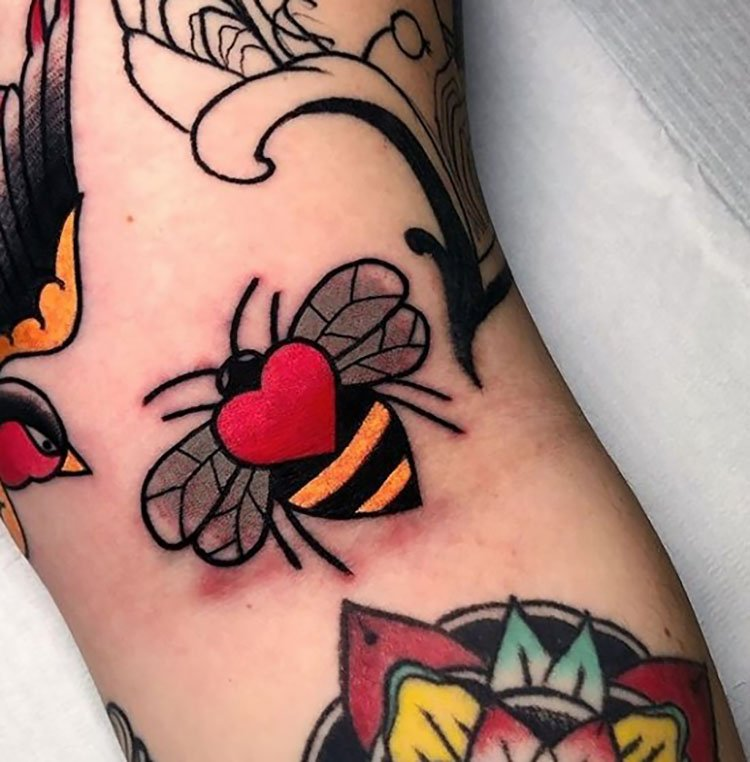 colorful bee with red heart