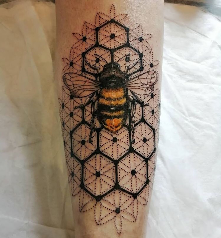 large bee tattoo with honeycomb