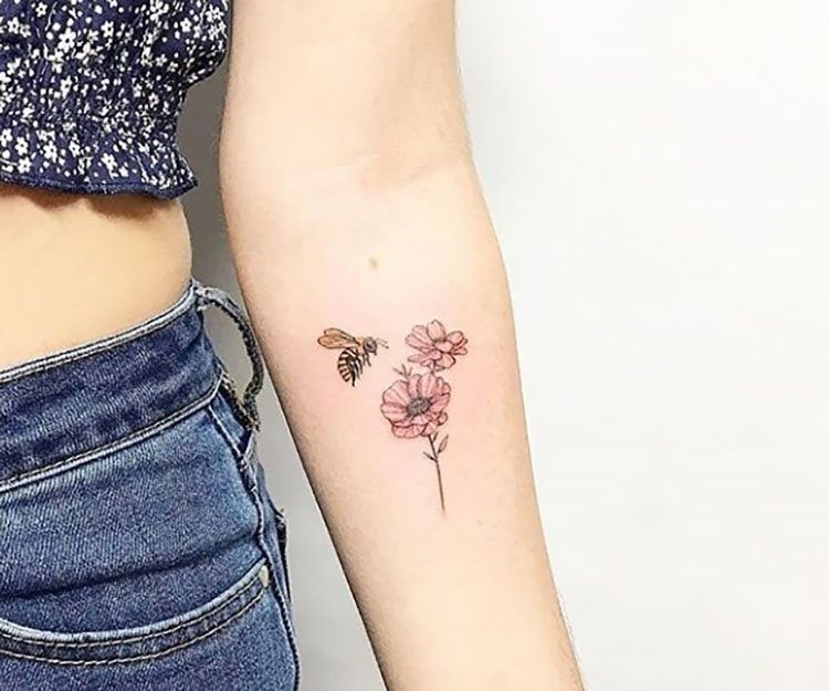 bee with flower on inner arm