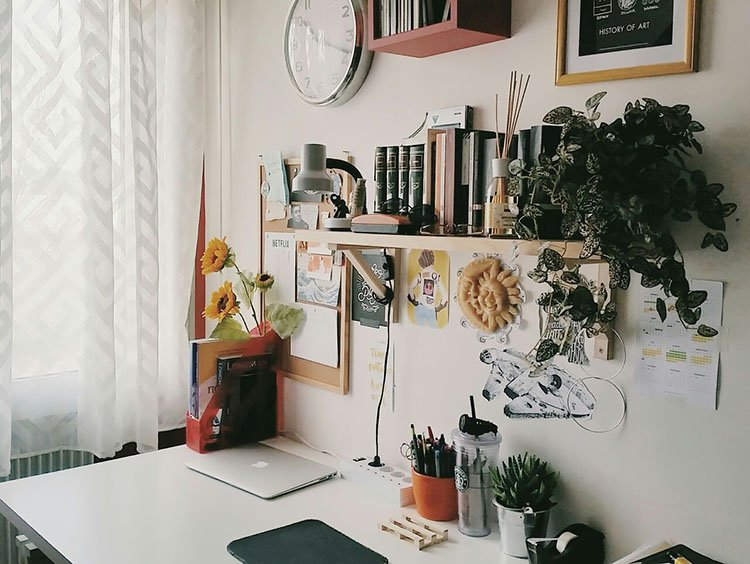 small office space with floating shelves