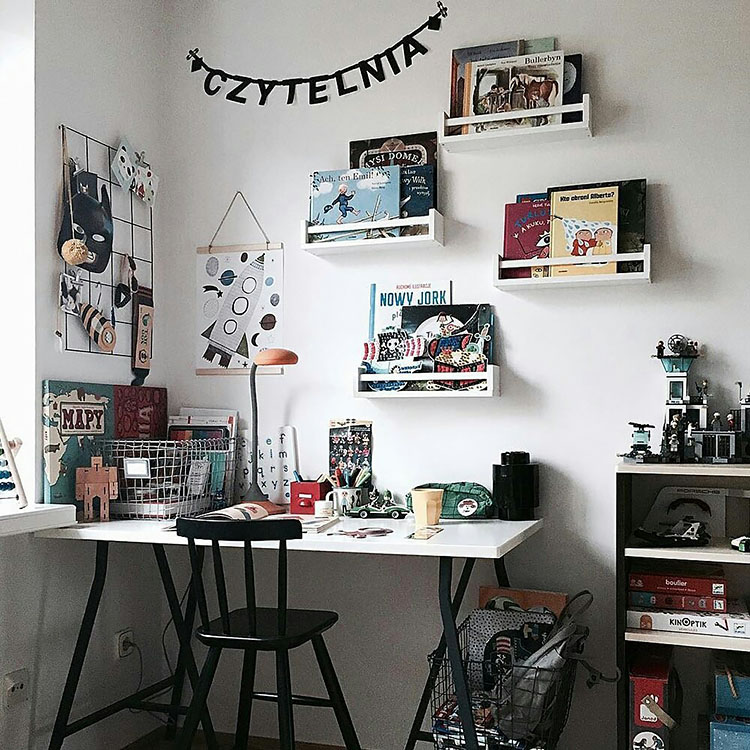office with childrens books on wall