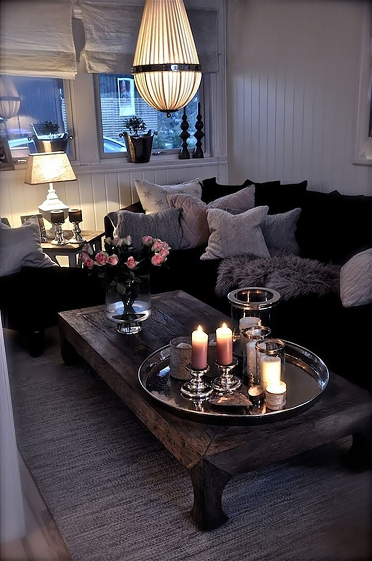 couch with pillows and candles