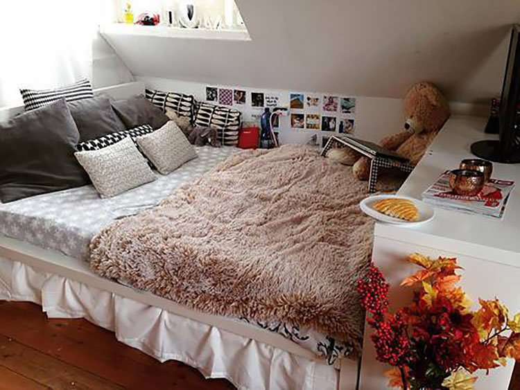 cozy bed with shaggy blanket