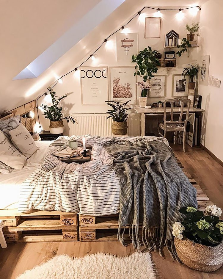 bed sitting on pallets