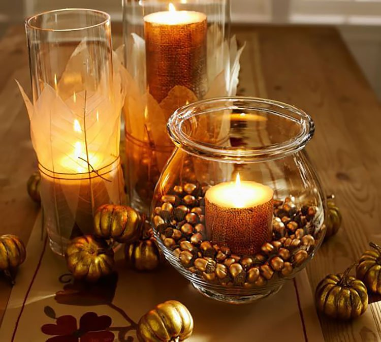 candles in jar with acorns