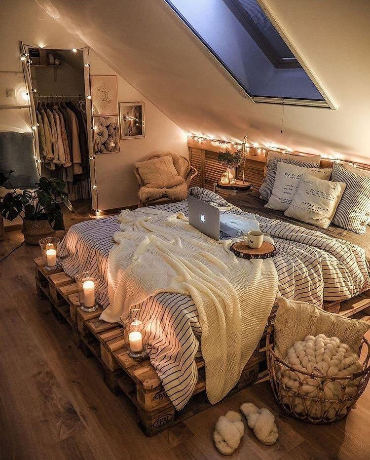 bed on pallets with candles