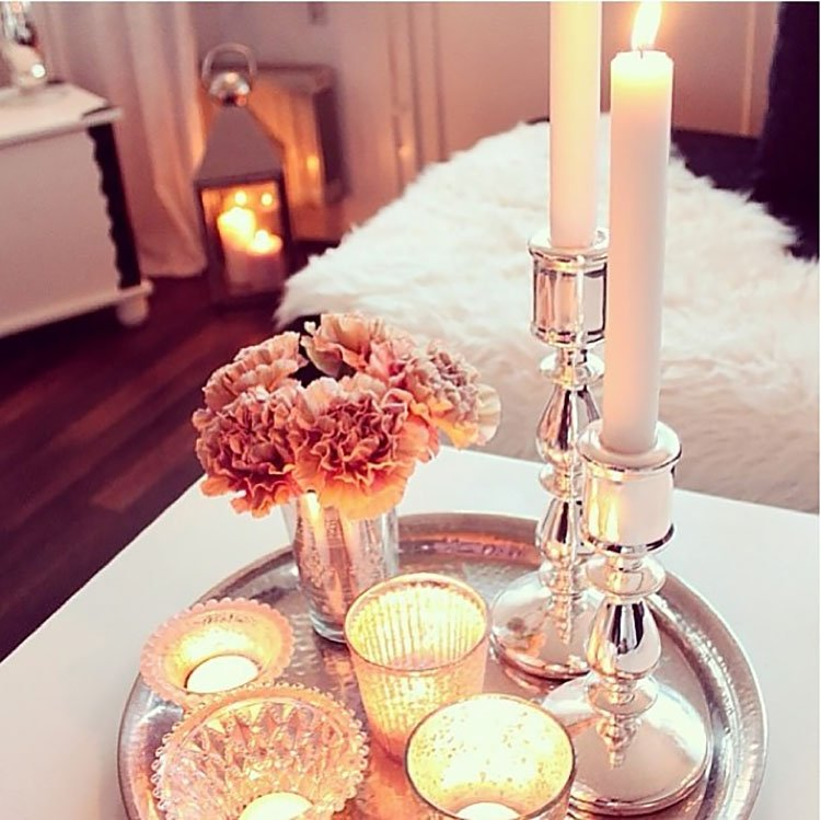 pink flowers with candles
