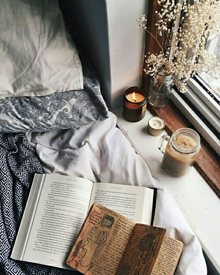 book with candle in window