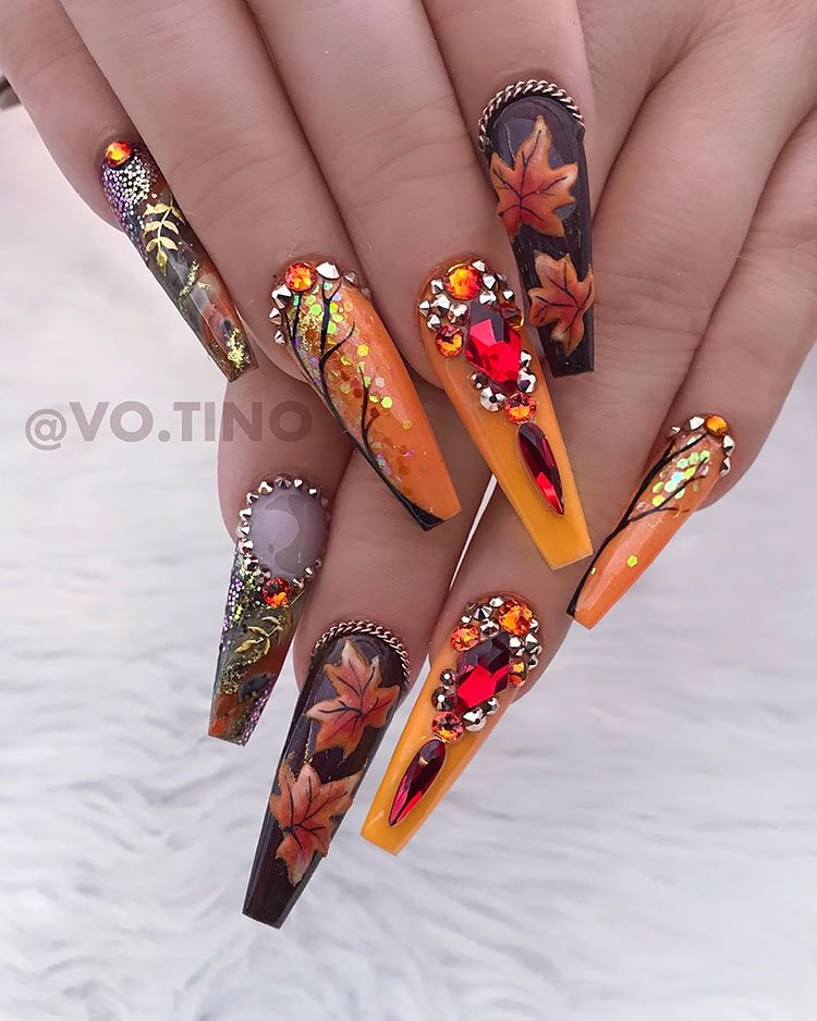 long orange and brown nails with leaves