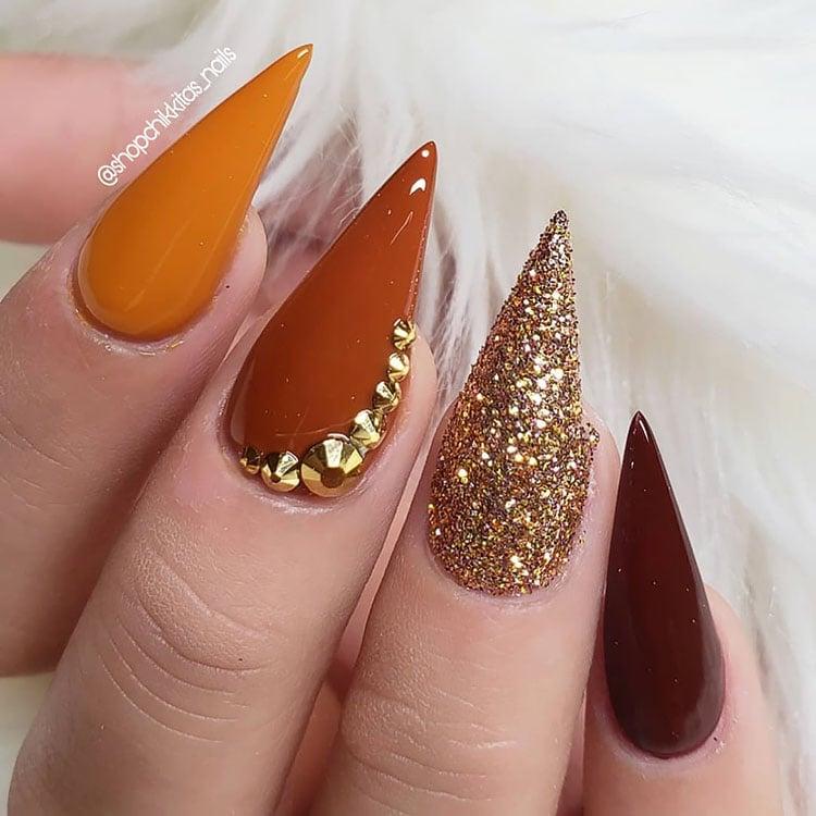 stiletto orange and glitter nails