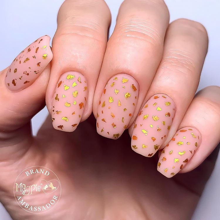 nude nails with gold flecks