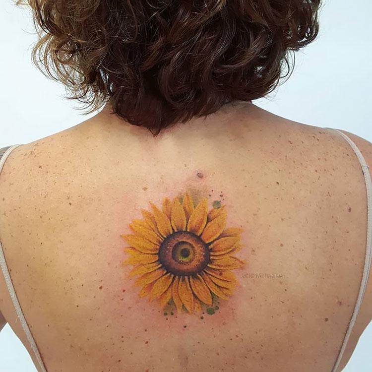 sunflower tattoo on back