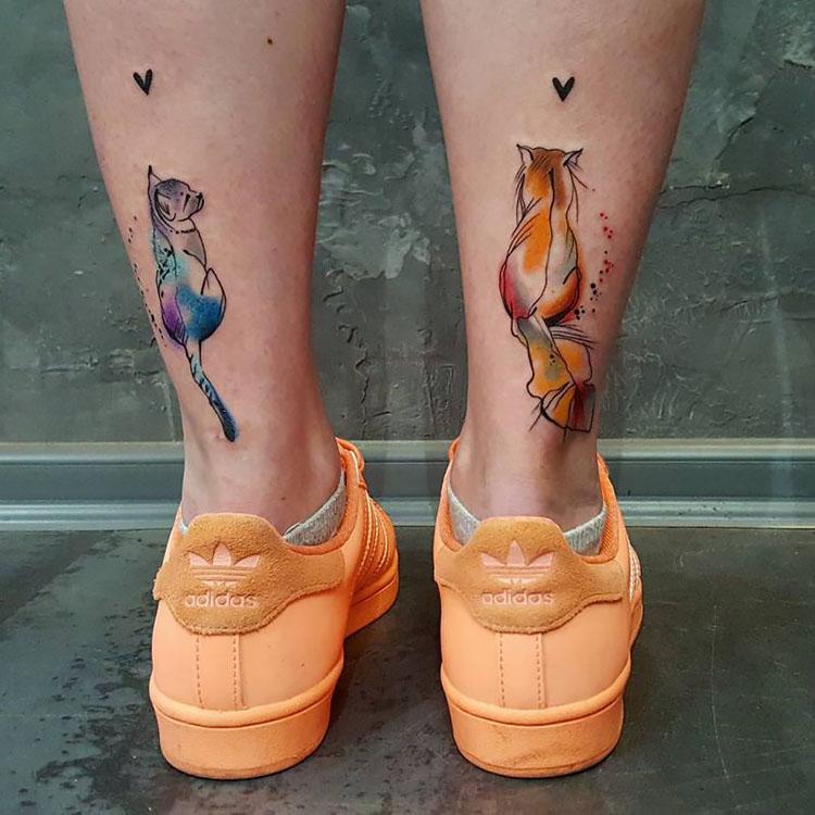 cat tattoos on leg