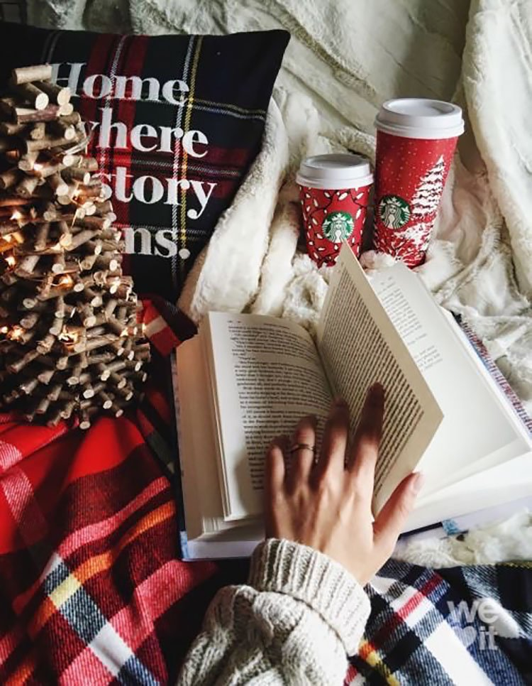 WOMAN READING BOOK WITH COFFEE CUP