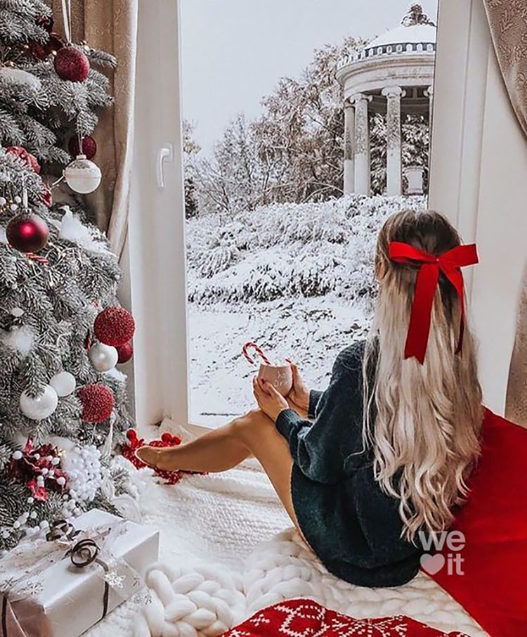 WOMAN LOOKING AT SNOWY SCENE
