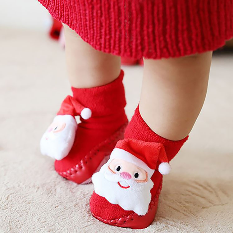 BABY WEARING CHRISTMAS SLIPPERS