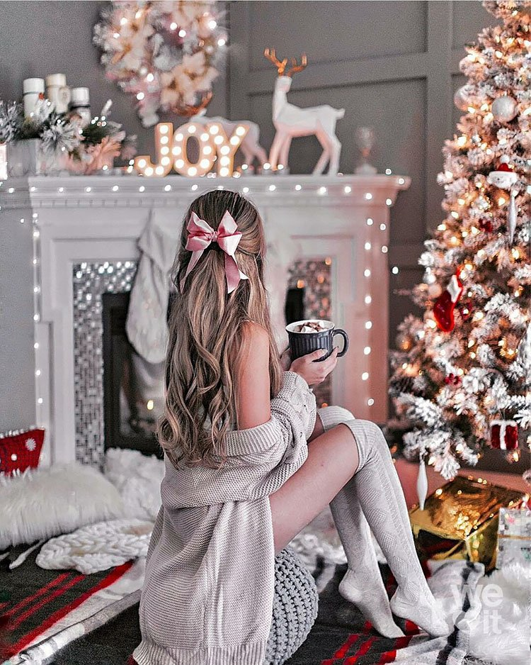 WOMEN SITTING IN FRONT OF CHRISTMAS TREE