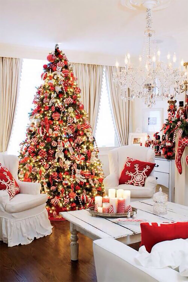 CHRISTMAS TREE FILLED WITH RED AND WHITE ORNAMENTS