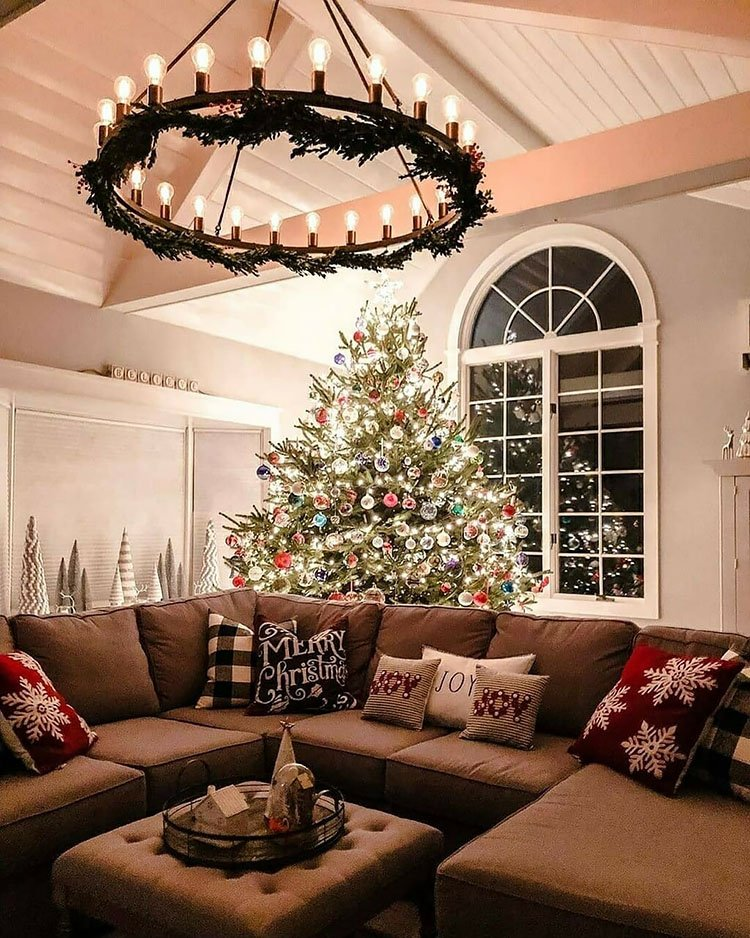 LARGE REAL CHRISTMAS TREE BEHIND COUCH