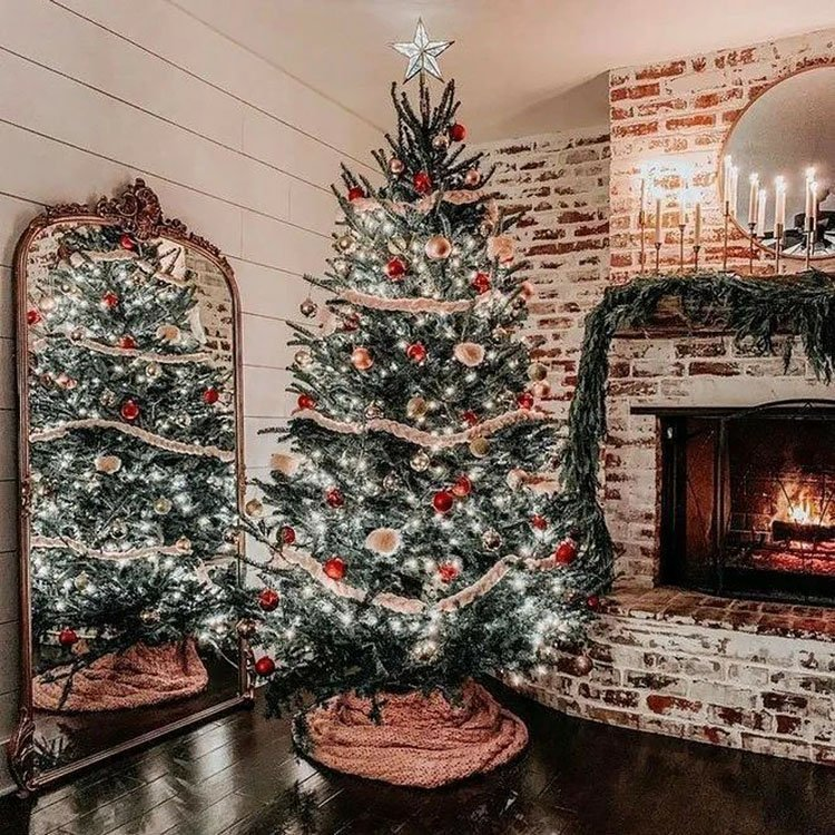 CHRISTMAS TREE BY FIRE PLACE