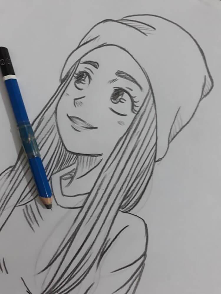 girl wearing beanie drawing
