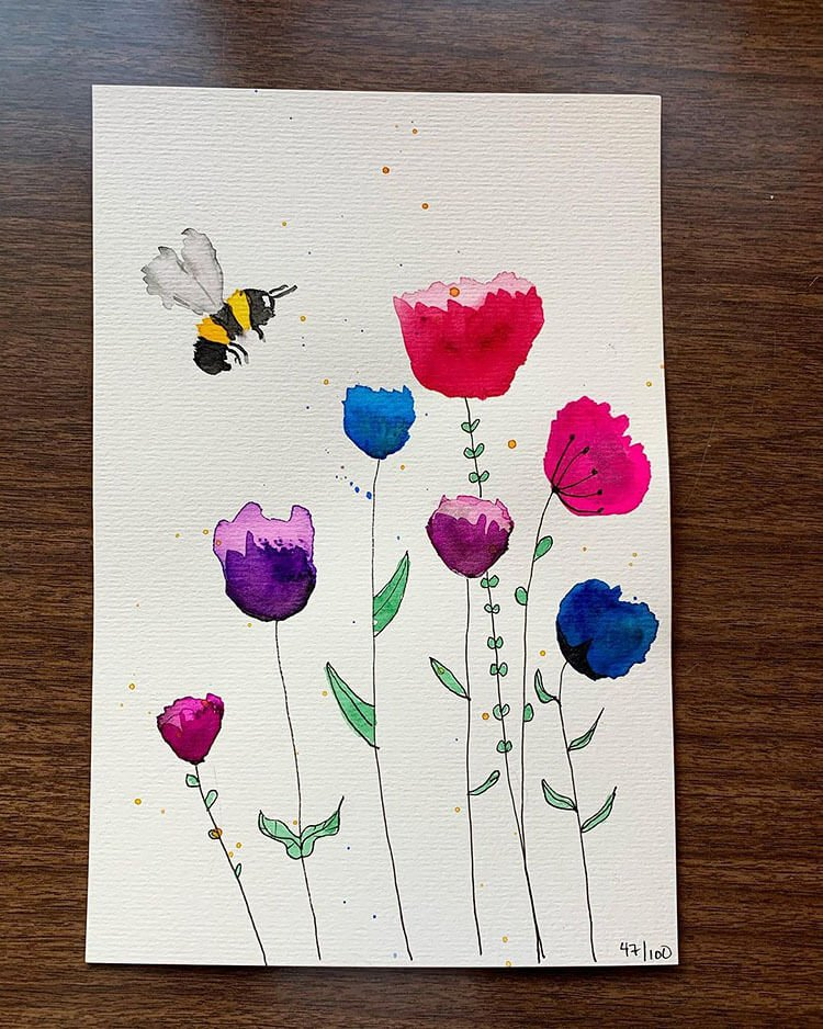 bright watercolor flowers with bee
