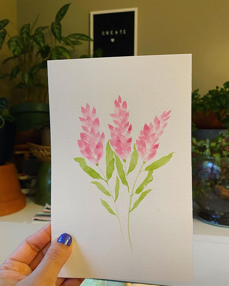 pink watercolor flowers with green leaves