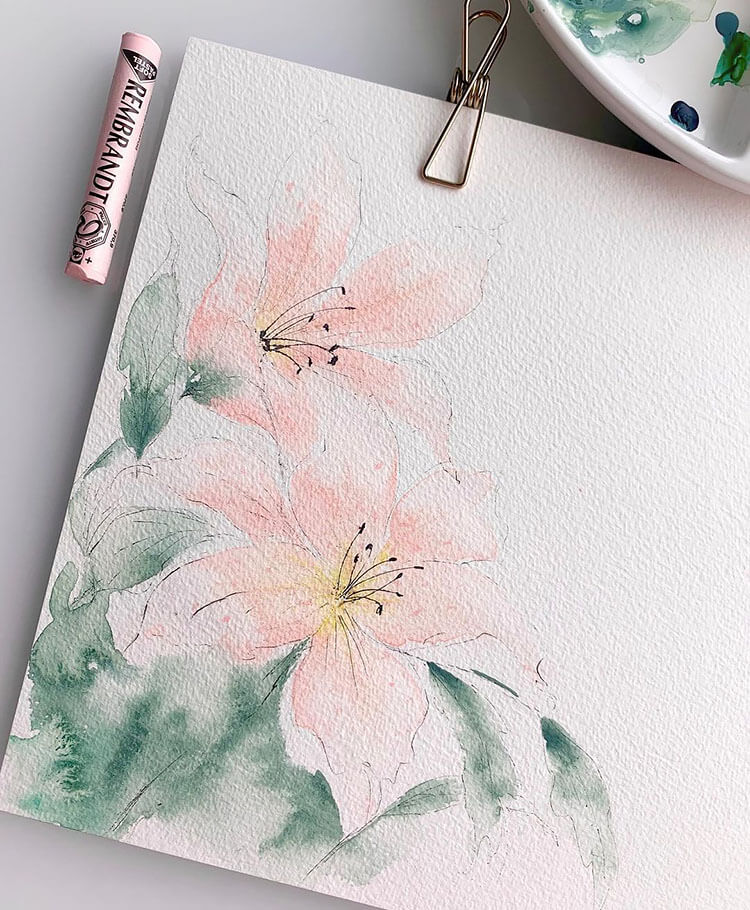 watercolor pink flower with green leaves