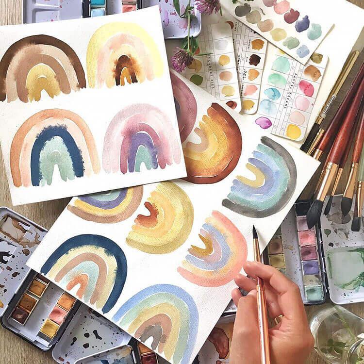 multiple rainbow paintings