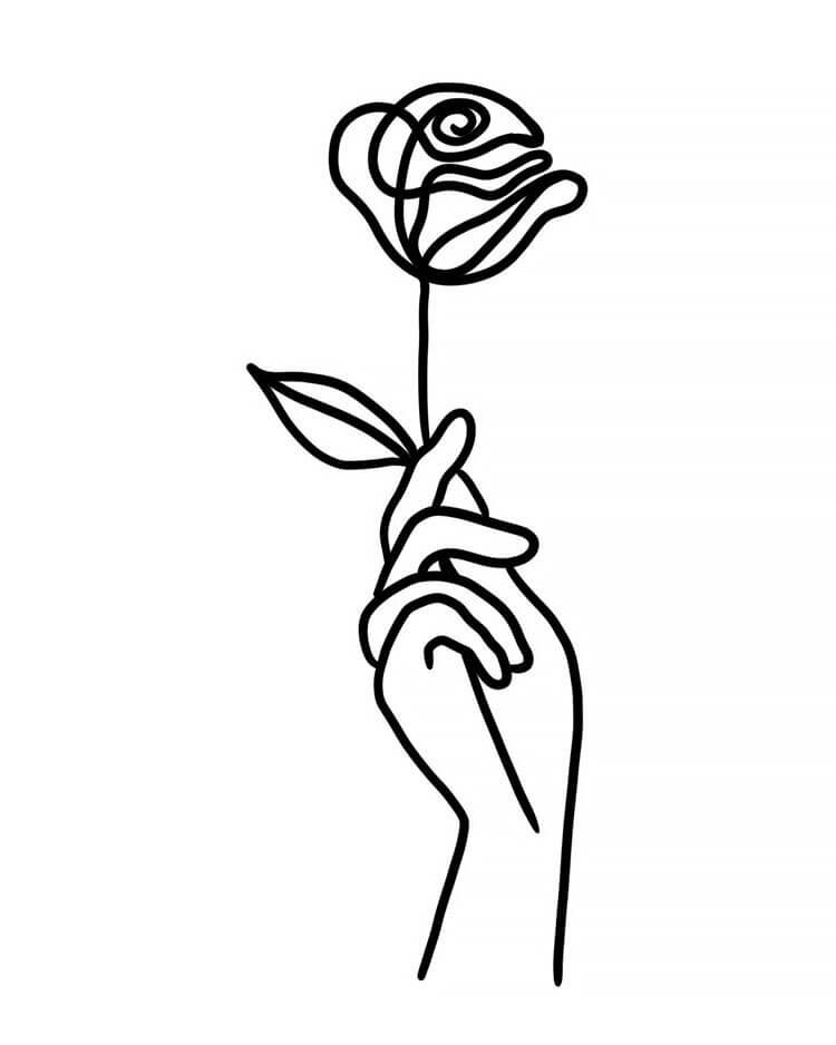 mano sosteniendo rosa