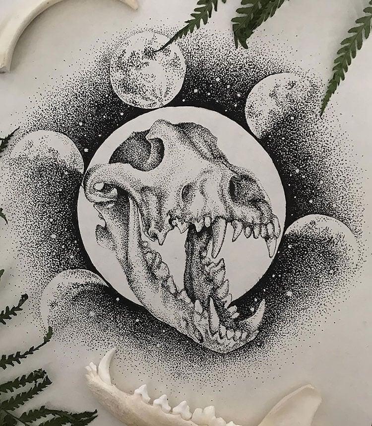 dinosaur skull with moons
