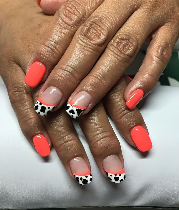 red cow print nails