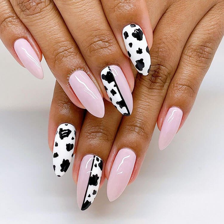 pink and black nails with cow print