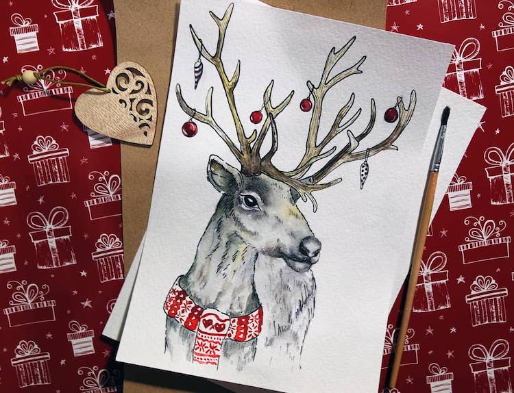 watercolor reindeer with ornaments