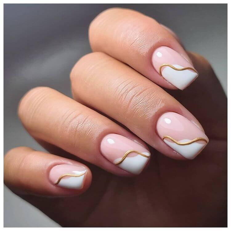 beautiful white and gold nails