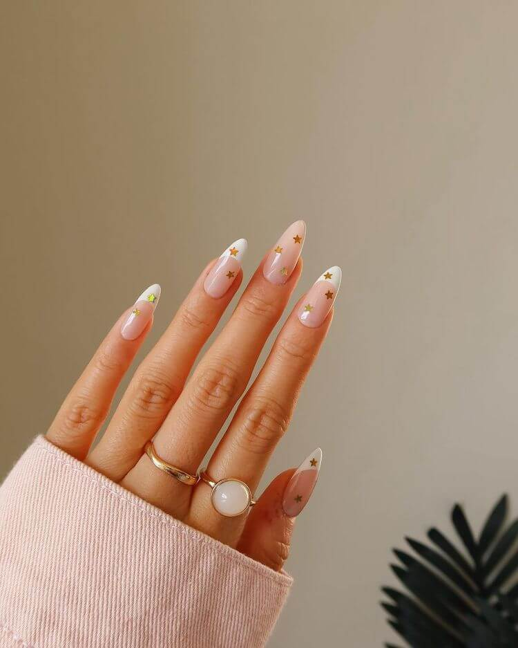 beautiful white and gold star nails