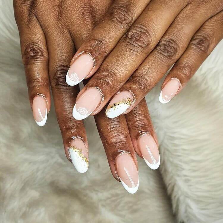 black women with white and gold nails