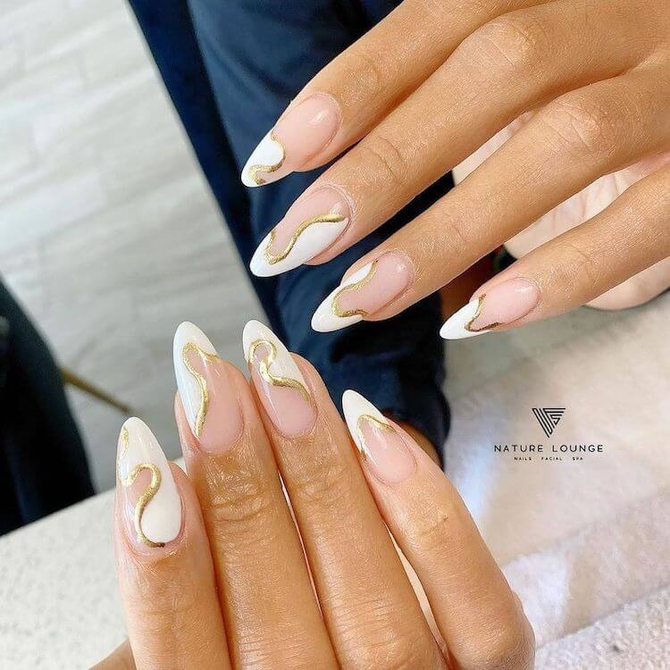 almond white and gold nails